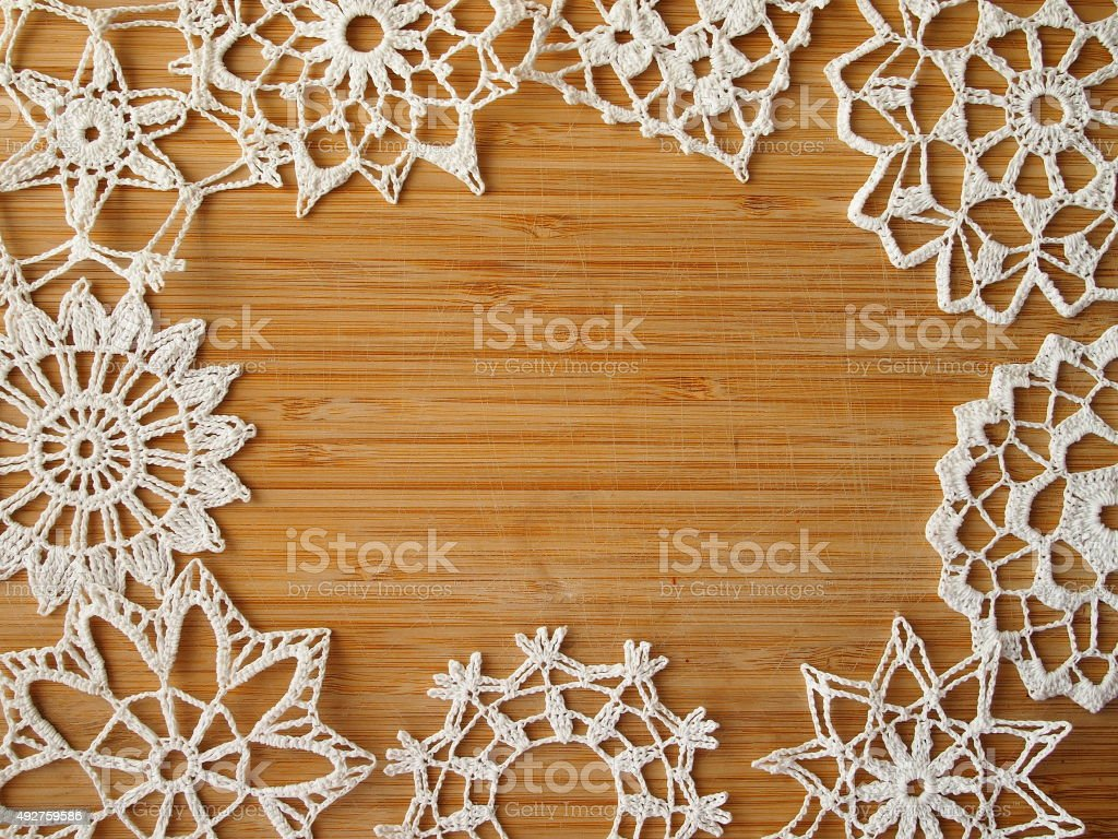 Crocheted snow flakes stock photo