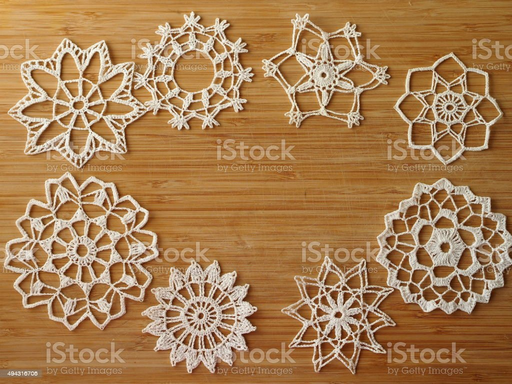 Crocheted snow flakes stock photo