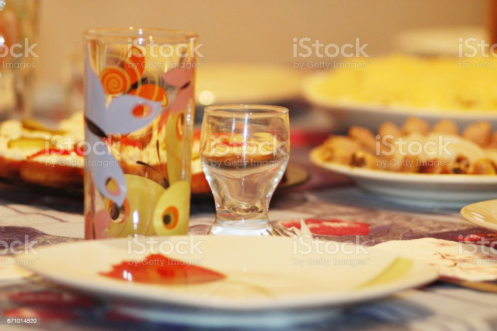 crockery glass plate wine-glass and dishes on the served table stock photo