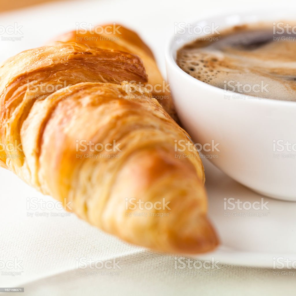 Croissant and a cup of delicous coffee stock photo