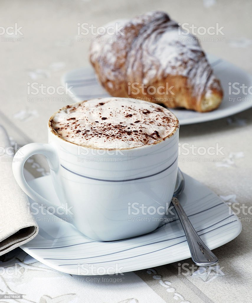 A croissant and hot chocolate for breakfast royalty-free stock photo