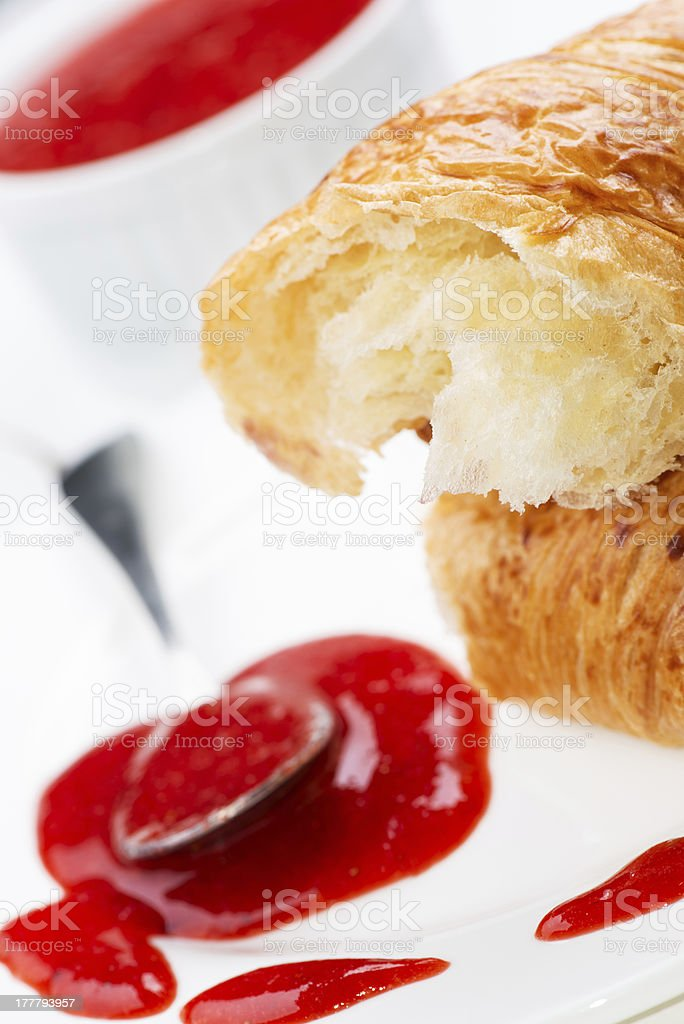 Croissant and strawberry jam in bowl royalty-free stock photo