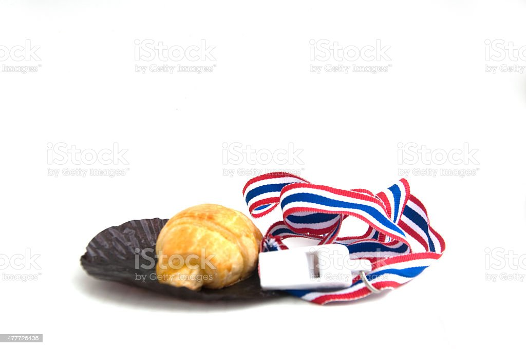 Croissant and Thai whistle - isolated on white stock photo