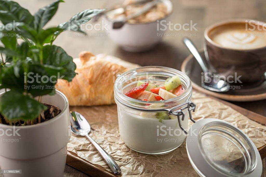 Croissant and yogurt with berries stock photo