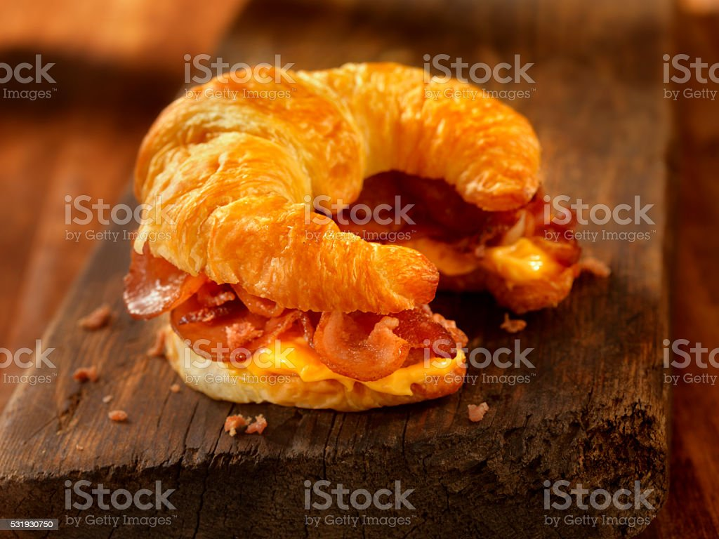 Croissant Breakfast Sandwich with Bacon and Cheese stock photo