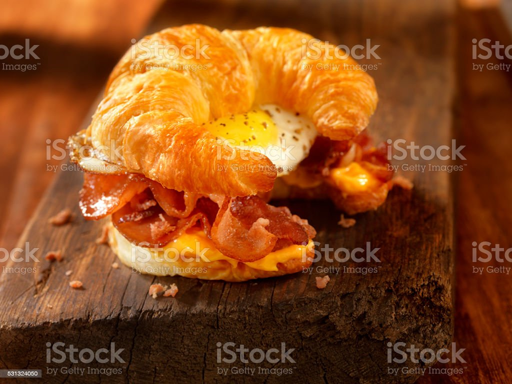Croissant Breakfast Sandwich with Bacon,egg and Cheese stock photo