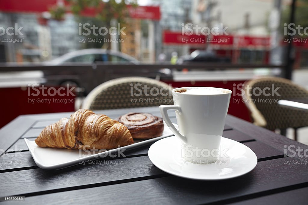 Croissant danish pastries with cappuccino drink on table royalty-free stock photo