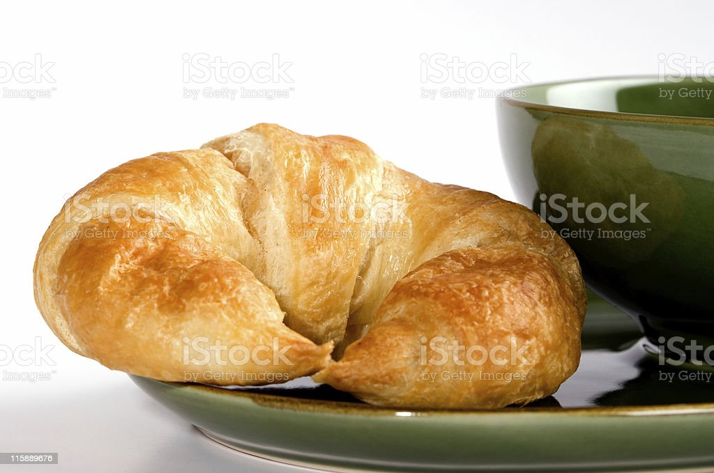 Croissant for breakfast on white background royalty-free stock photo