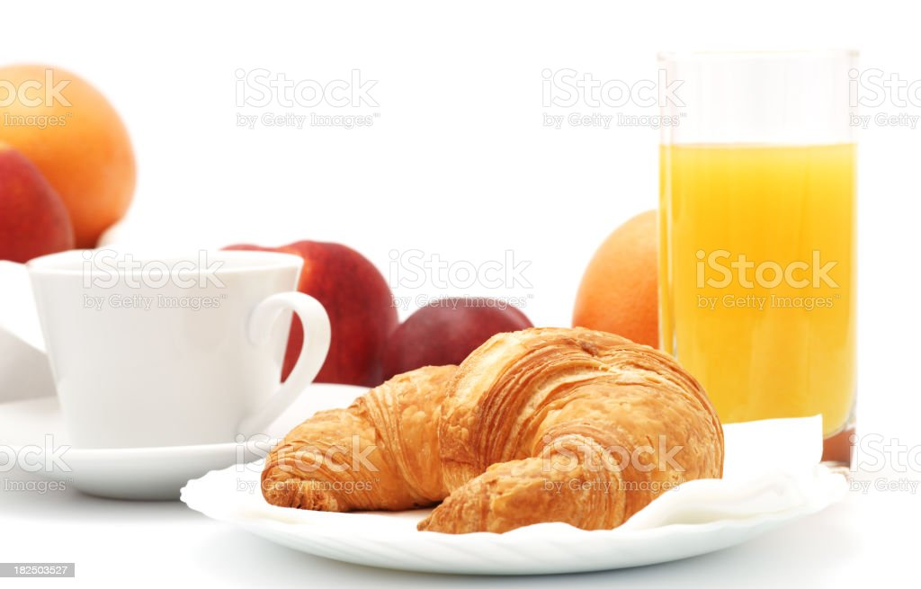 Croissant with coffee, fruit and juice on plate royalty-free stock photo