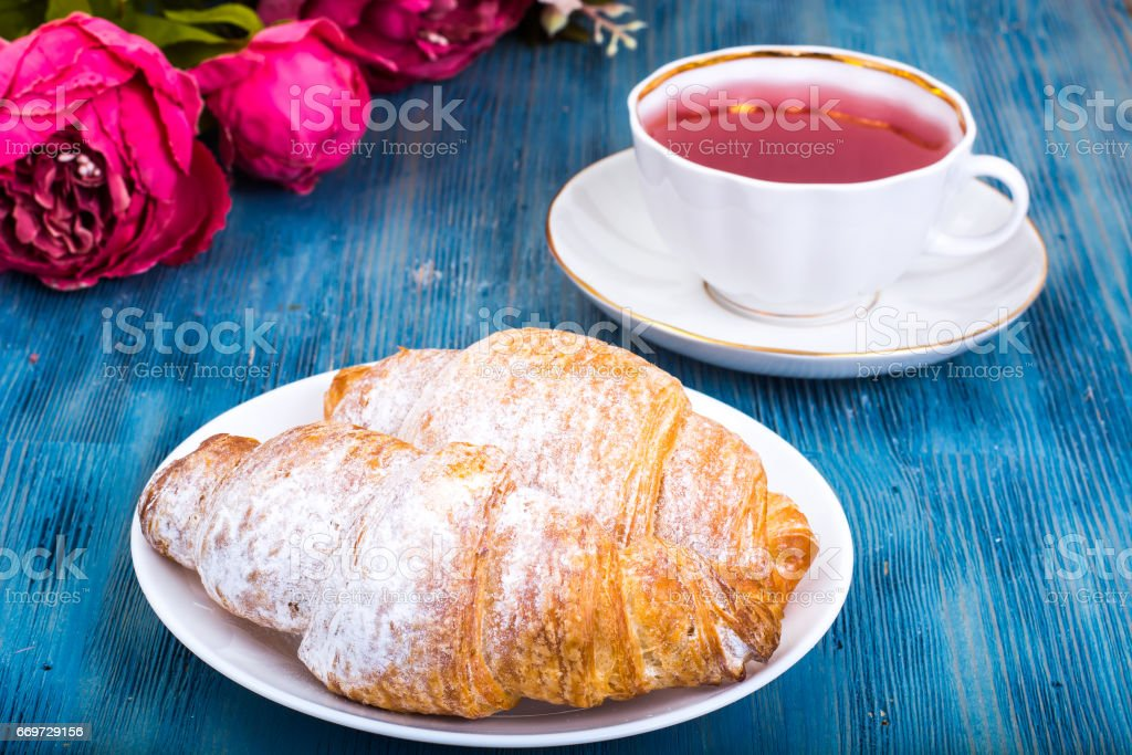 Croissant with kissel on blue background stock photo