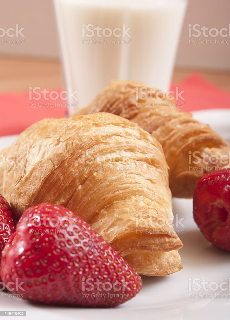 croissants close up with strawberry and milk royalty-free stock photo
