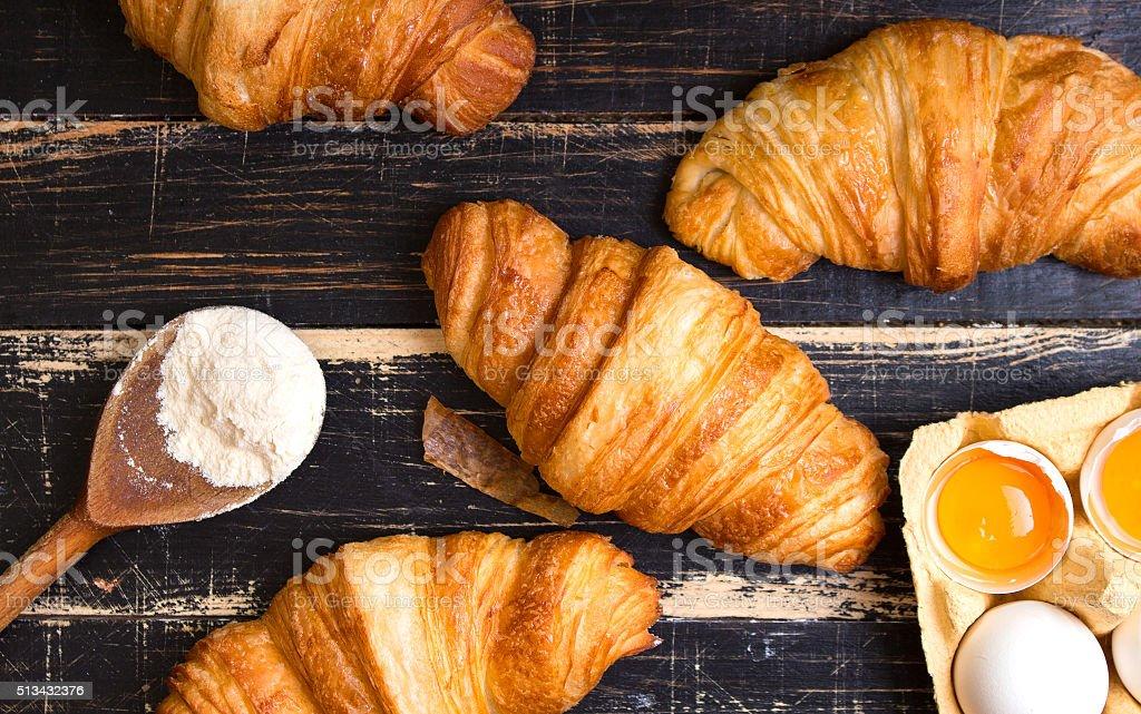 Croissants, flour, eggs, spoon, rolling pin stock photo