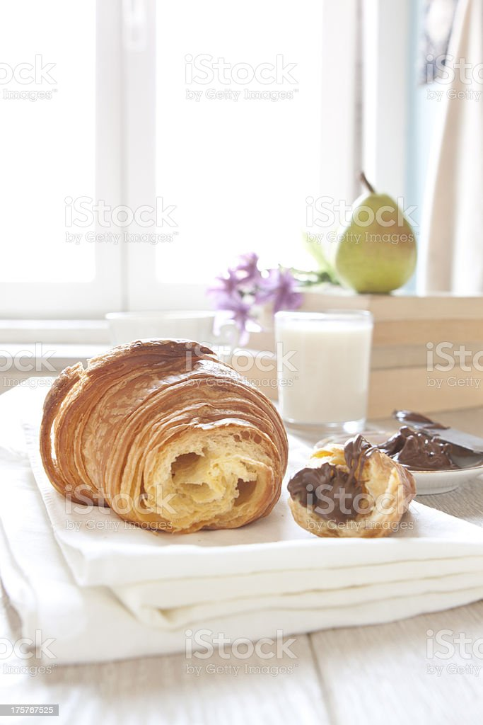 Croissants on table with chocolate royalty-free stock photo