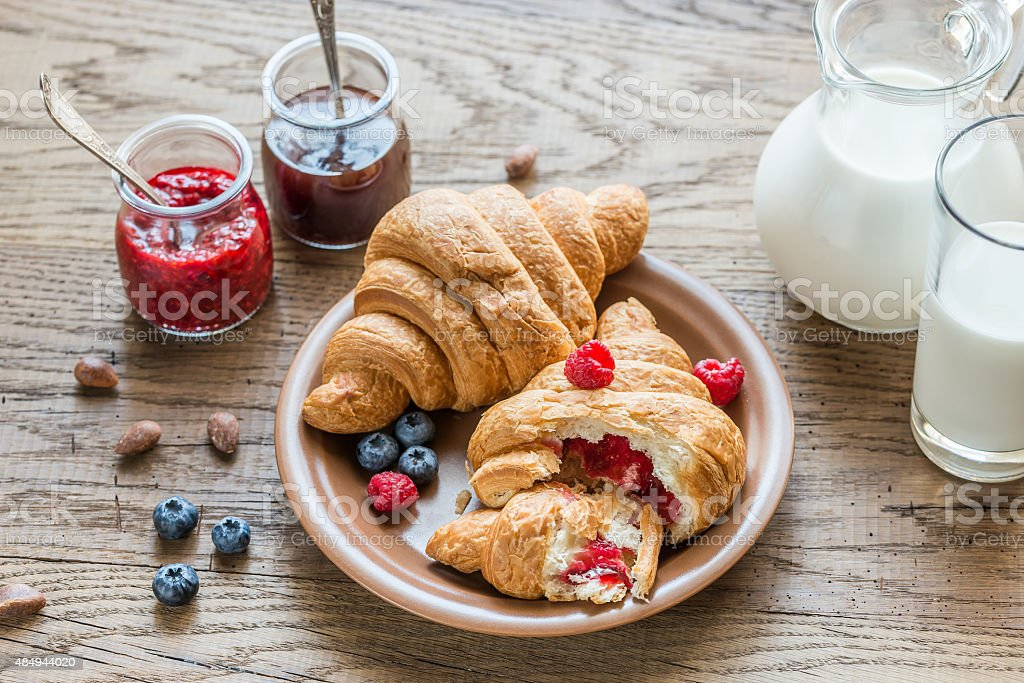 Croissants with fresh berries and jam stock photo