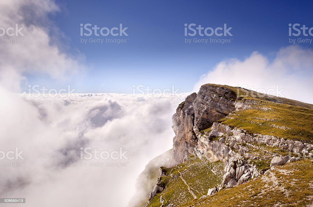 Crolles mountain between clouds stock photo