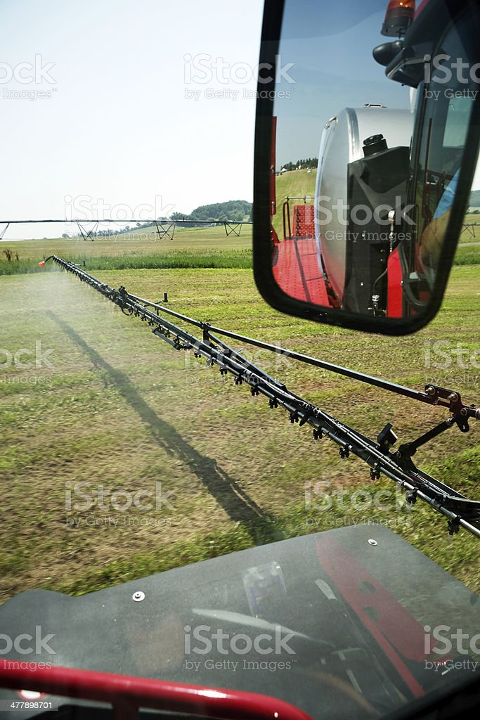 Crop Sprayer Spraying Field with Fertilizer, Herbicide or Insecticide stock photo