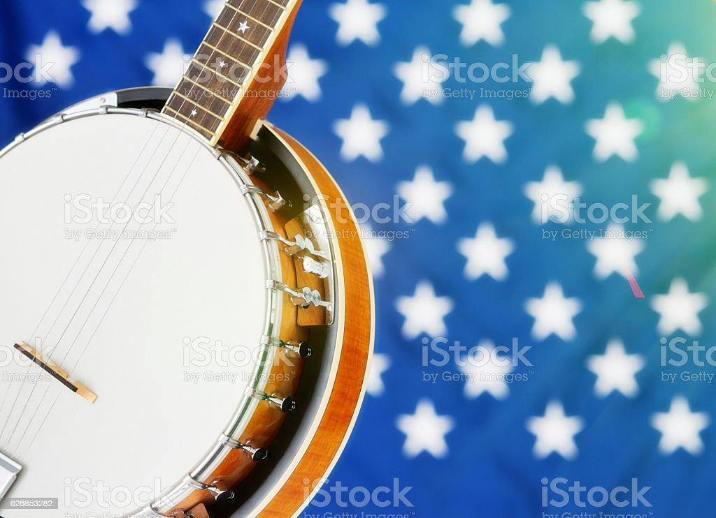 Cropped American traditional banjo with Stars & Stripes in background stock photo