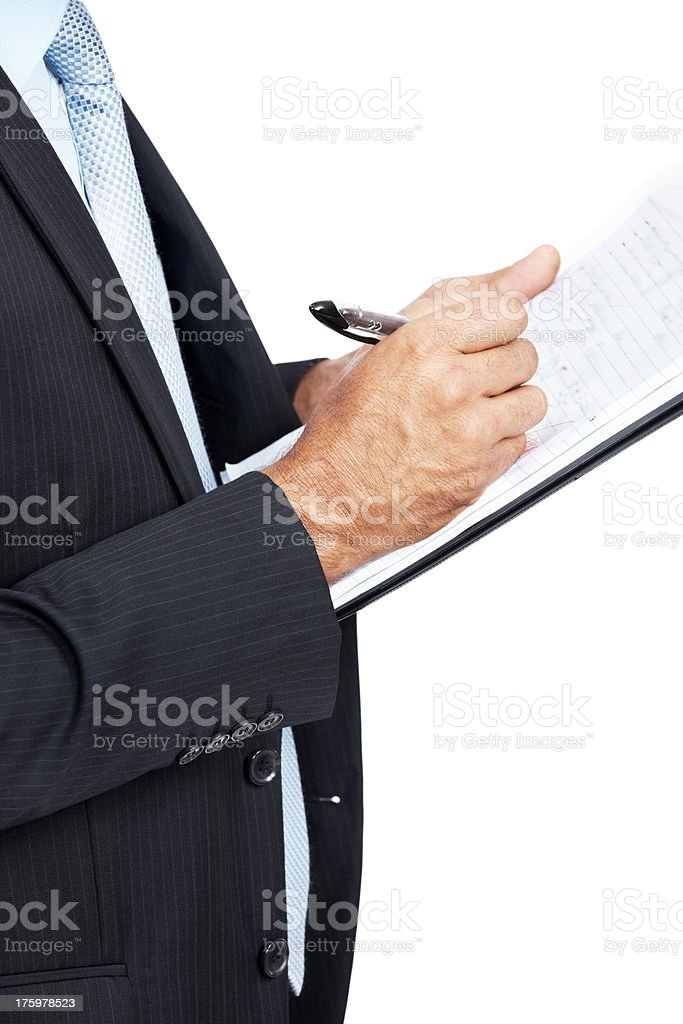 Cropped image of a businessman taking a notes on clipboard stock photo