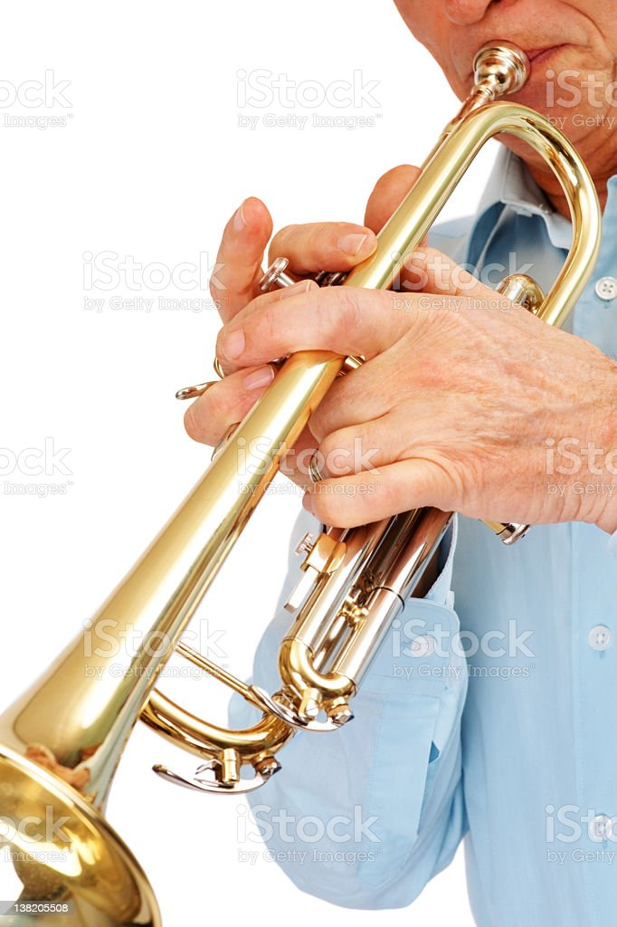 Cropped image of a man playing trumpet against white royalty-free stock photo