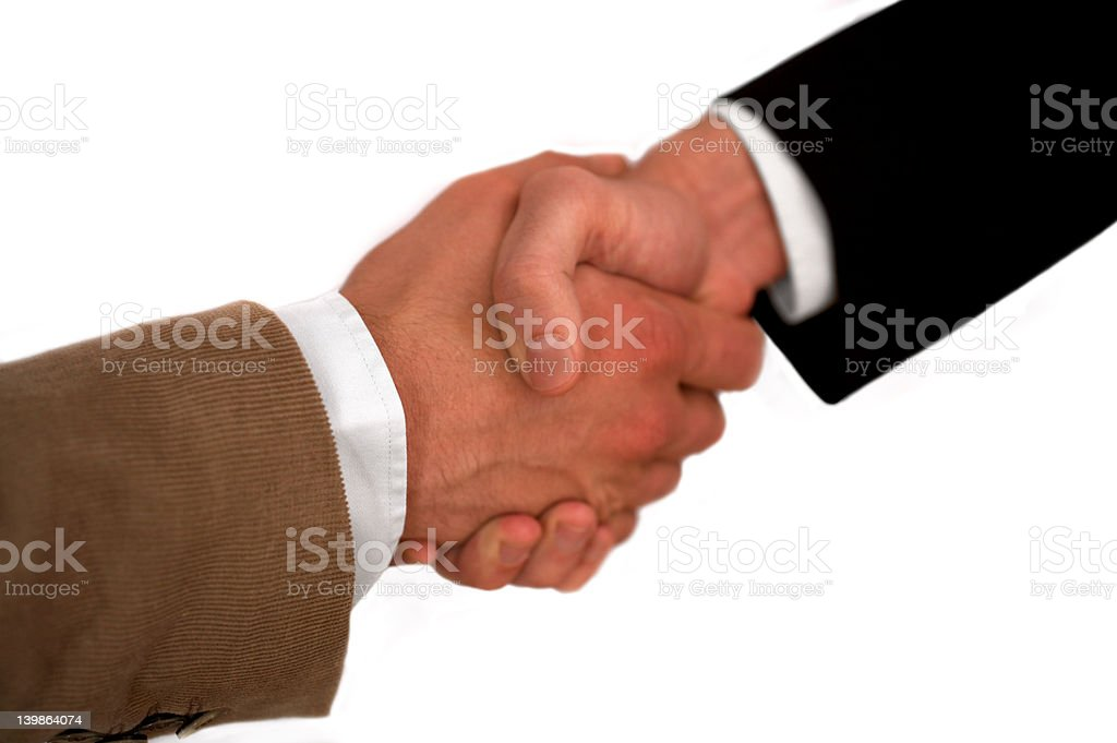Cropped image of business executives shaking hands royalty-free stock photo