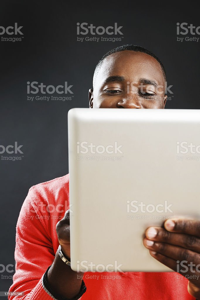Cropped image of handsome man looking down at digital tablet stock photo