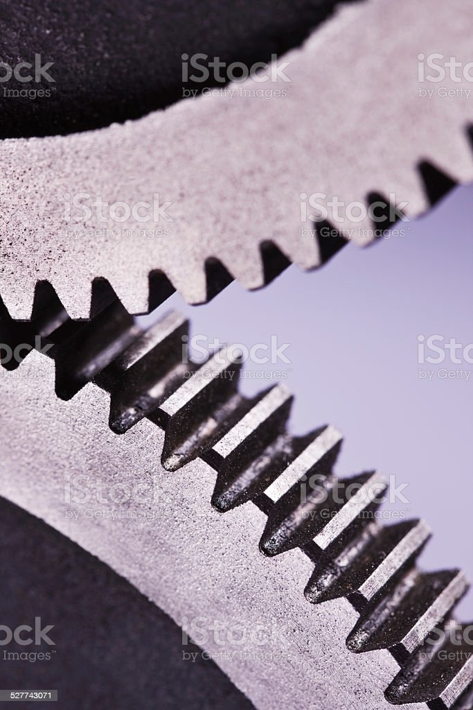 Cropped image of mechanical gears interlinked with eachother stock photo