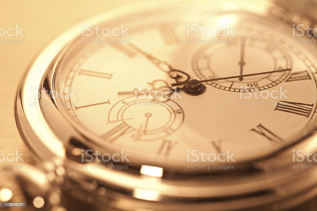 Cropped image of pocket watch stock photo