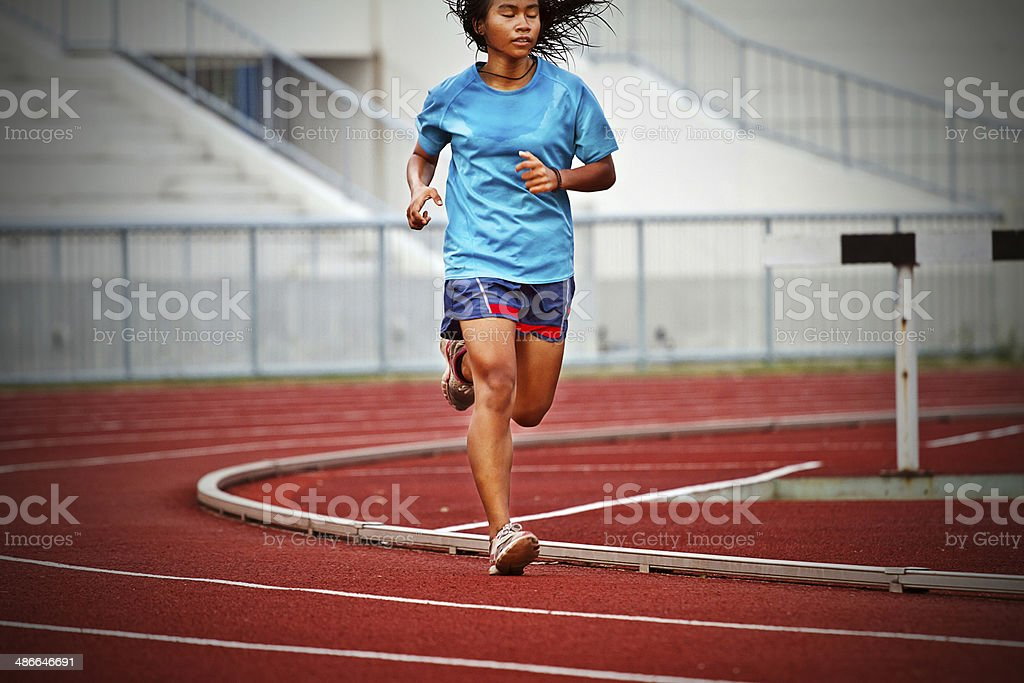 Cropped image of  runner on competitive running stock photo