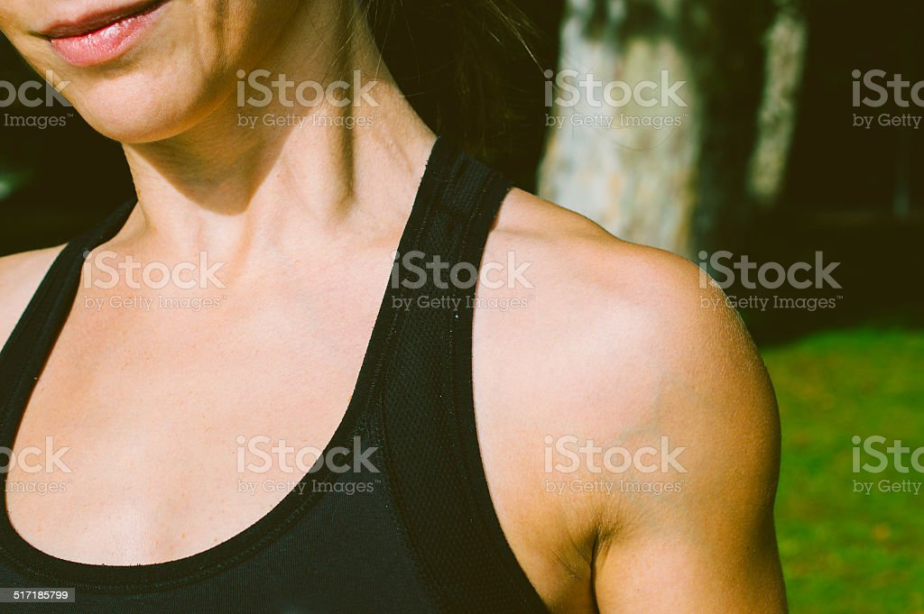 Cropped image of young female bodybuilder stock photo