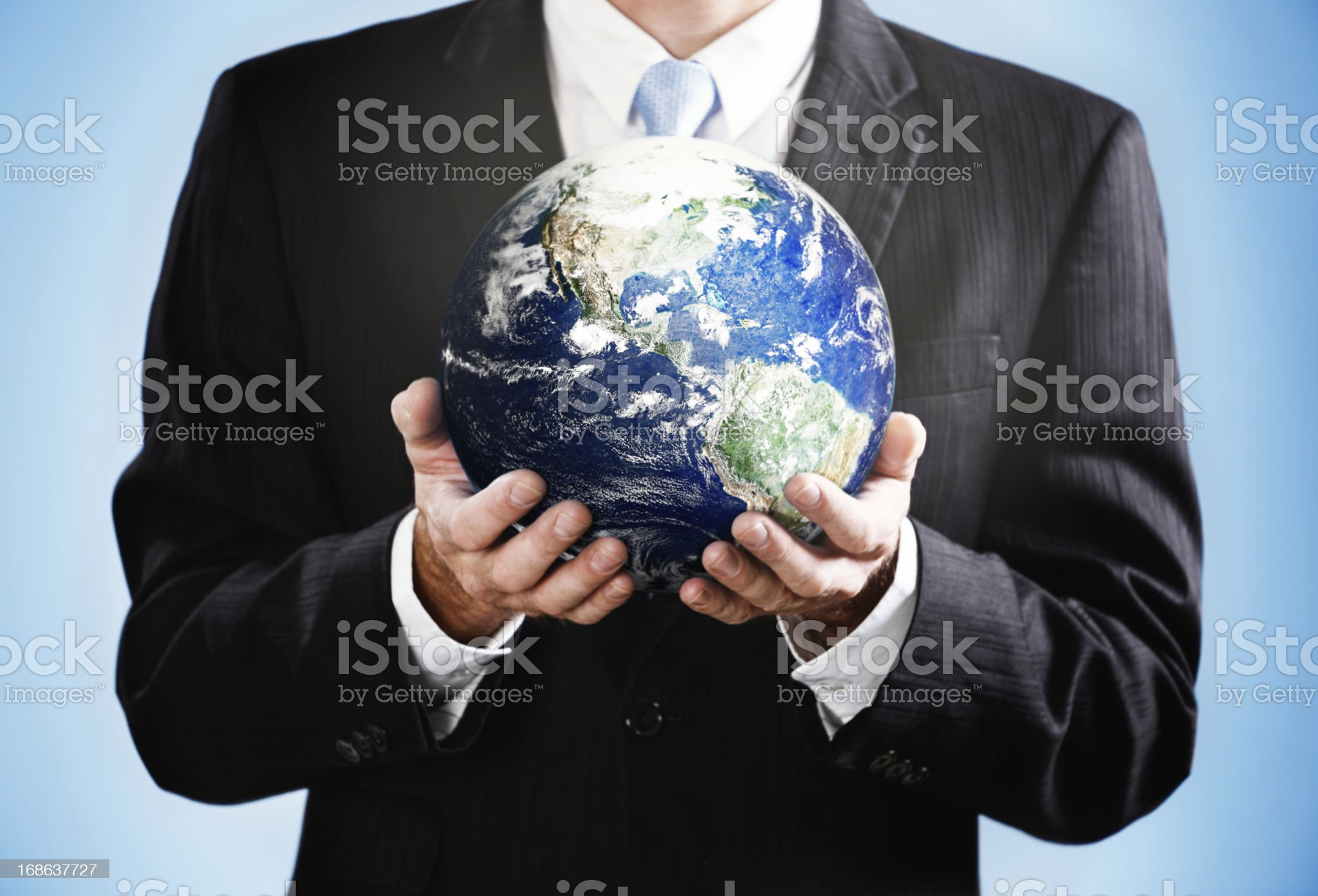 Cropped image with businessman holding satellite view of Earth royalty-free stock photo