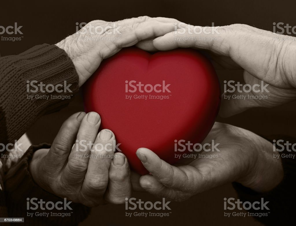 cropped, isolated picture, hands people, woman, man, holding red heart stock photo