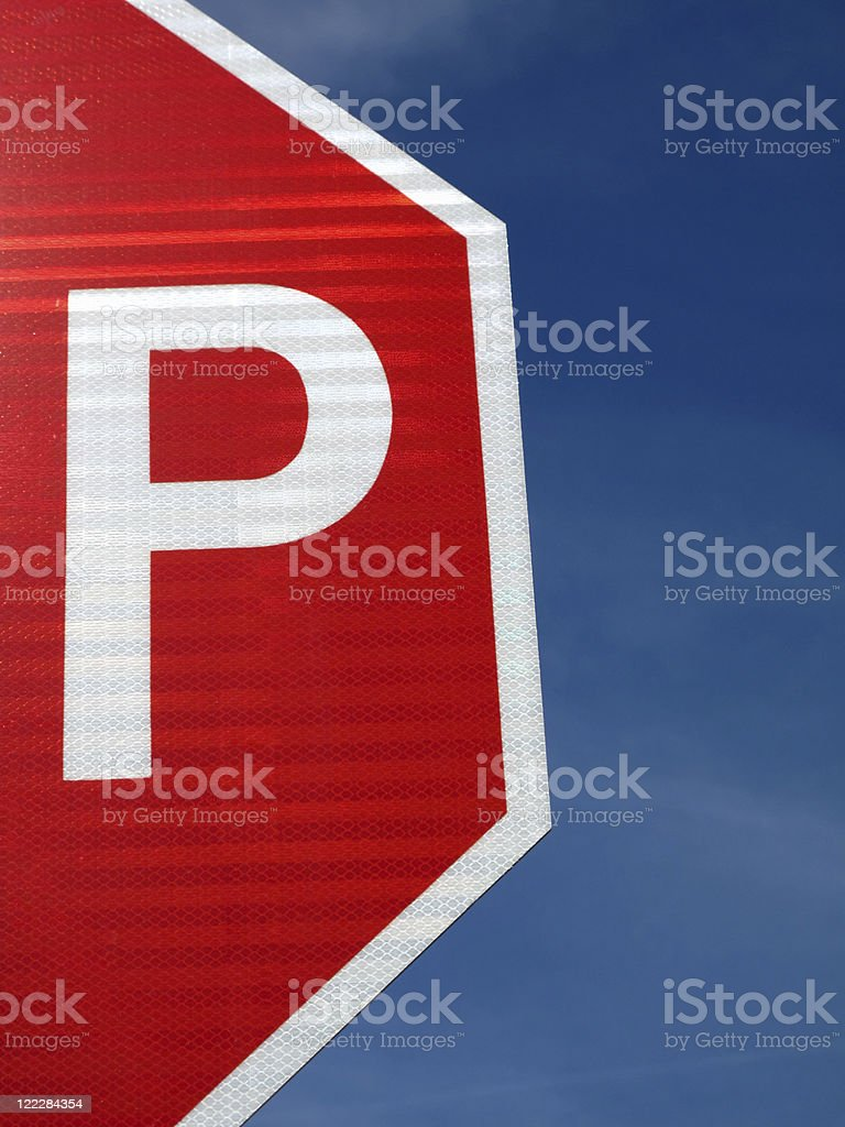 Cropped P of Stop Sign with Blue Sky royalty-free stock photo