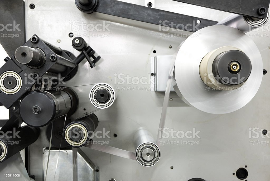 Cropped photo of metal industrial machine for rolling paper stock photo