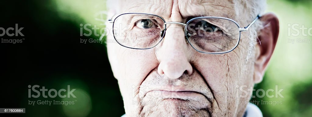 Cropped portrait of classic Grumpy Old Man stock photo