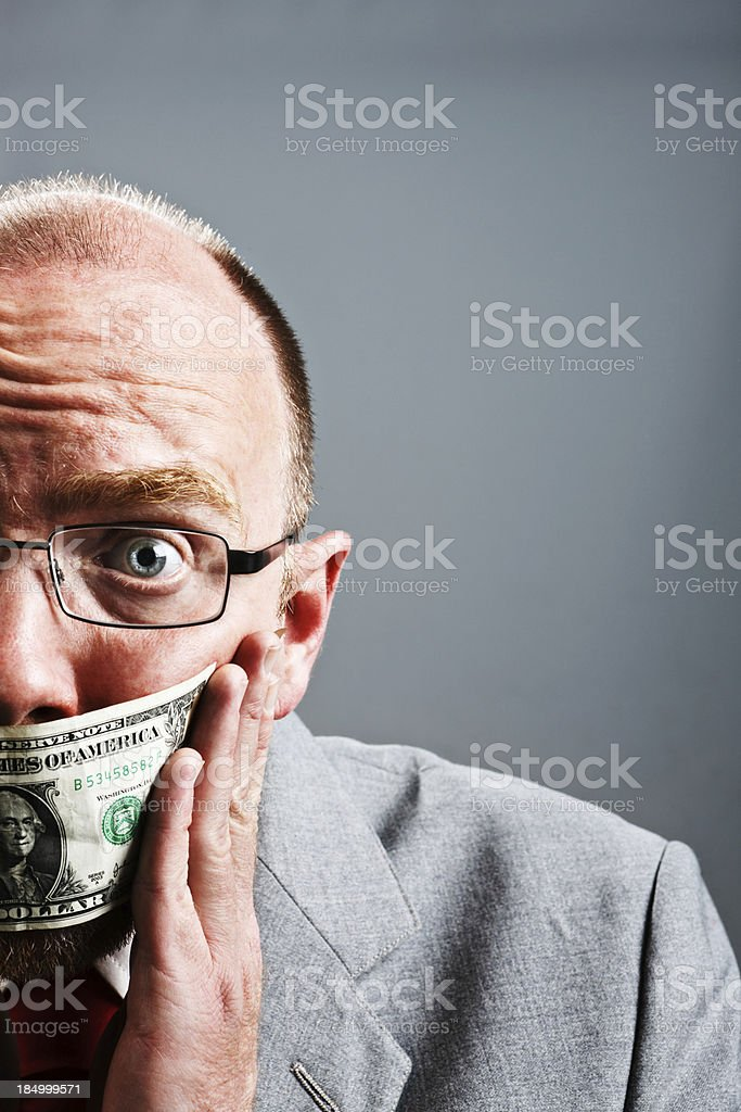 Cropped portrait of frightened businessman wearing dollar gag stock photo