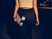 Cropped shot of a girl walking away carrying her skateboard