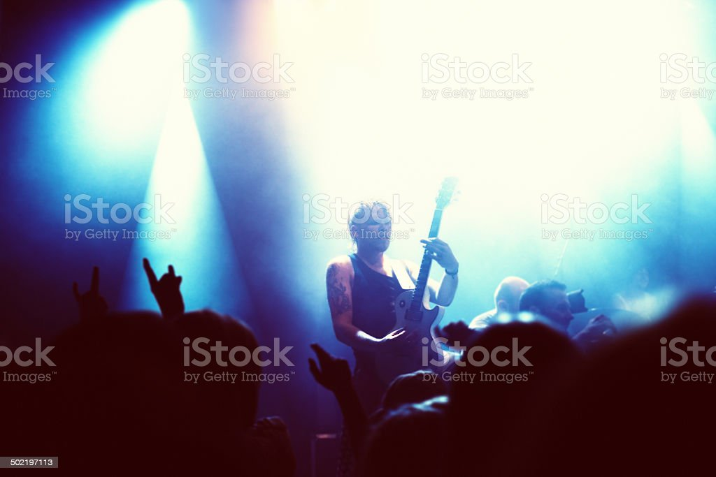 Playing his heart out for the fans stock photo