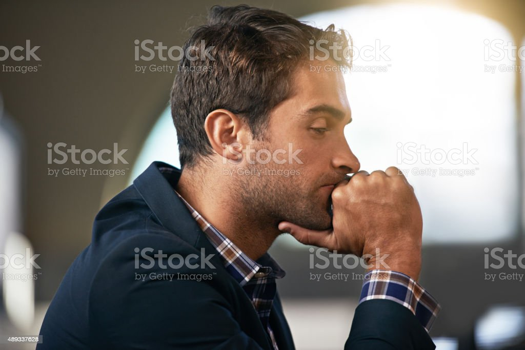 Trying to drink the stress away stock photo