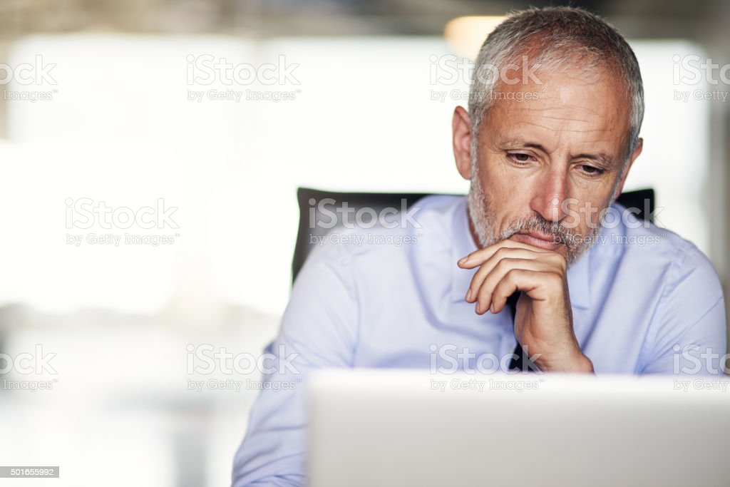 Putting a lot of thought into his work stock photo