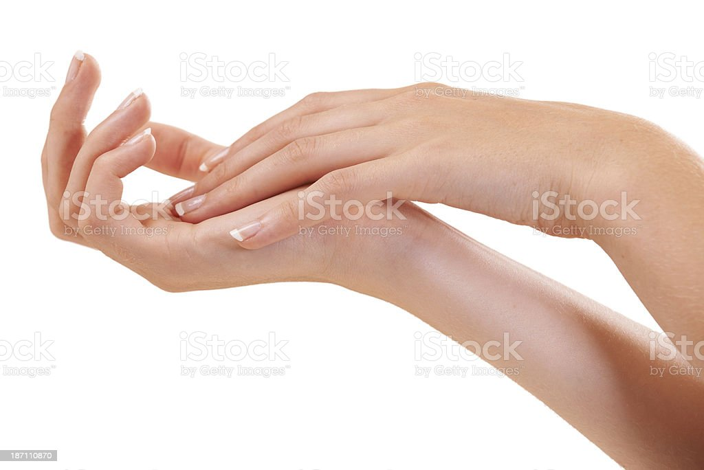 Making sure every inch of her hand is moisturized royalty-free stock photo