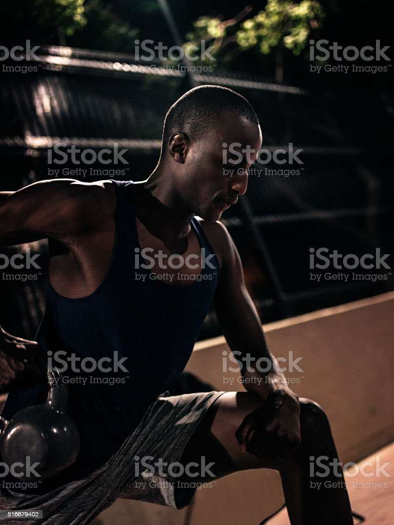 Cropped shot of african-american lifting kettle bell for weight stock photo
