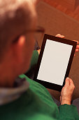 Cropped shot of senior man working with tablet