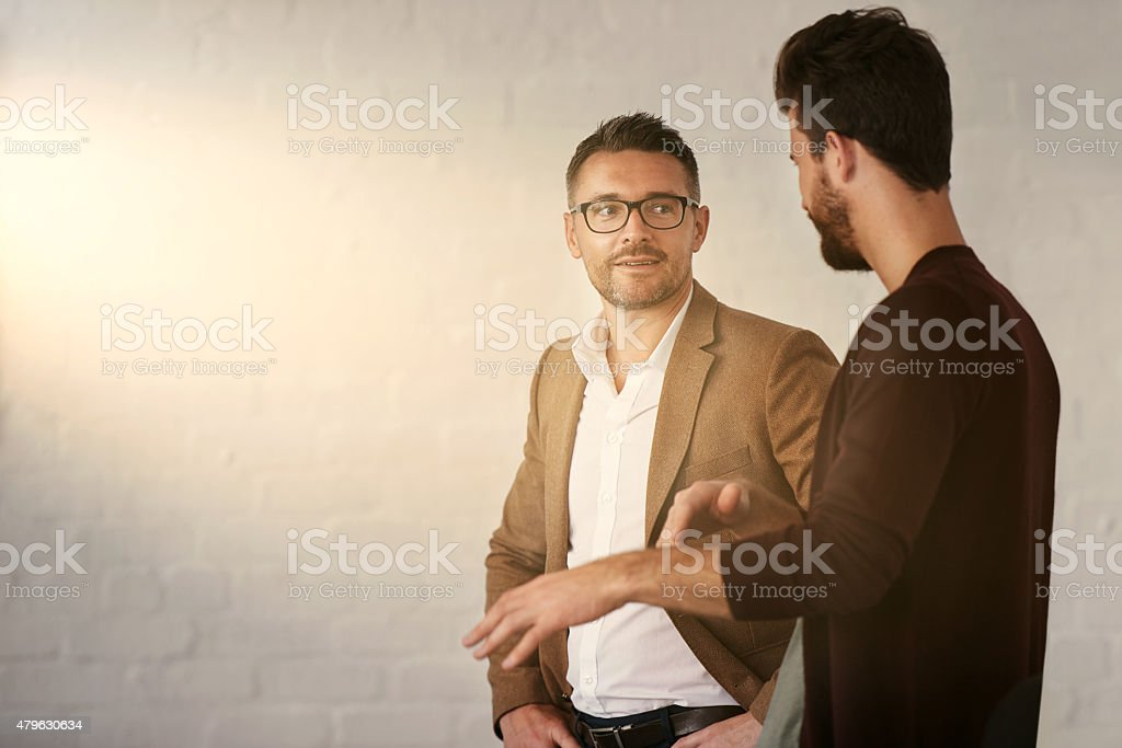Discussing a few business ideas stock photo