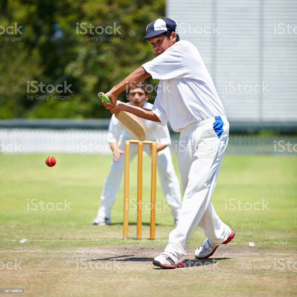 Cropped shot of two opposing cricket players during a match stock photo