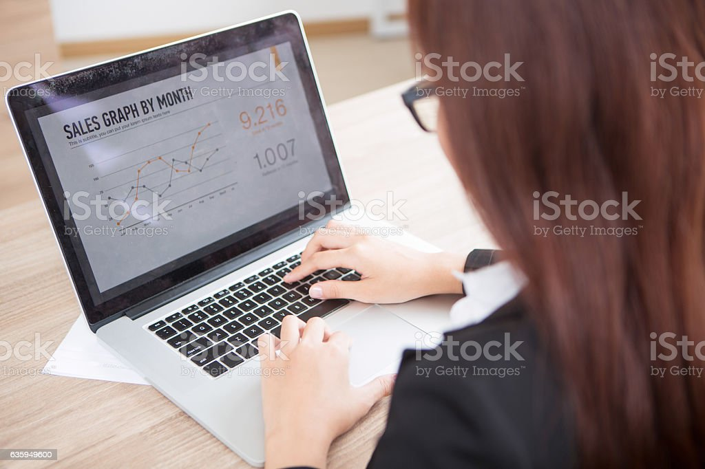 Cropped View of Business Woman Working on Laptop stock photo