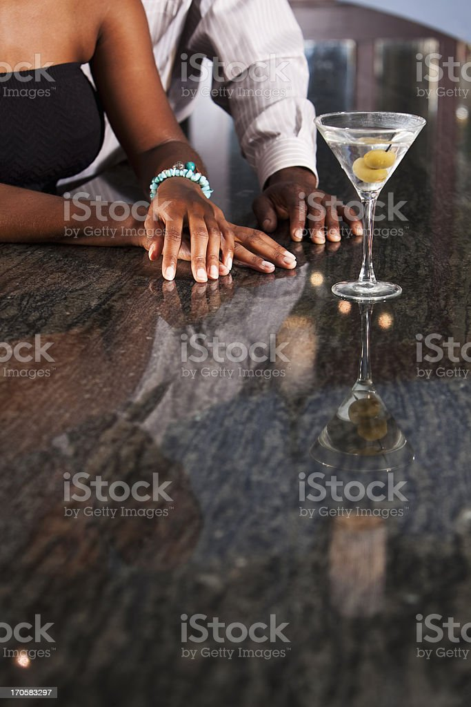 Cropped view of couple at bar royalty-free stock photo