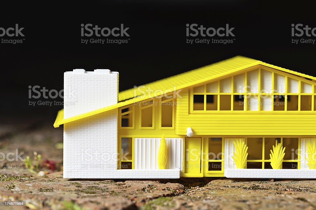Cropped view of detailed model house against black royalty-free stock photo