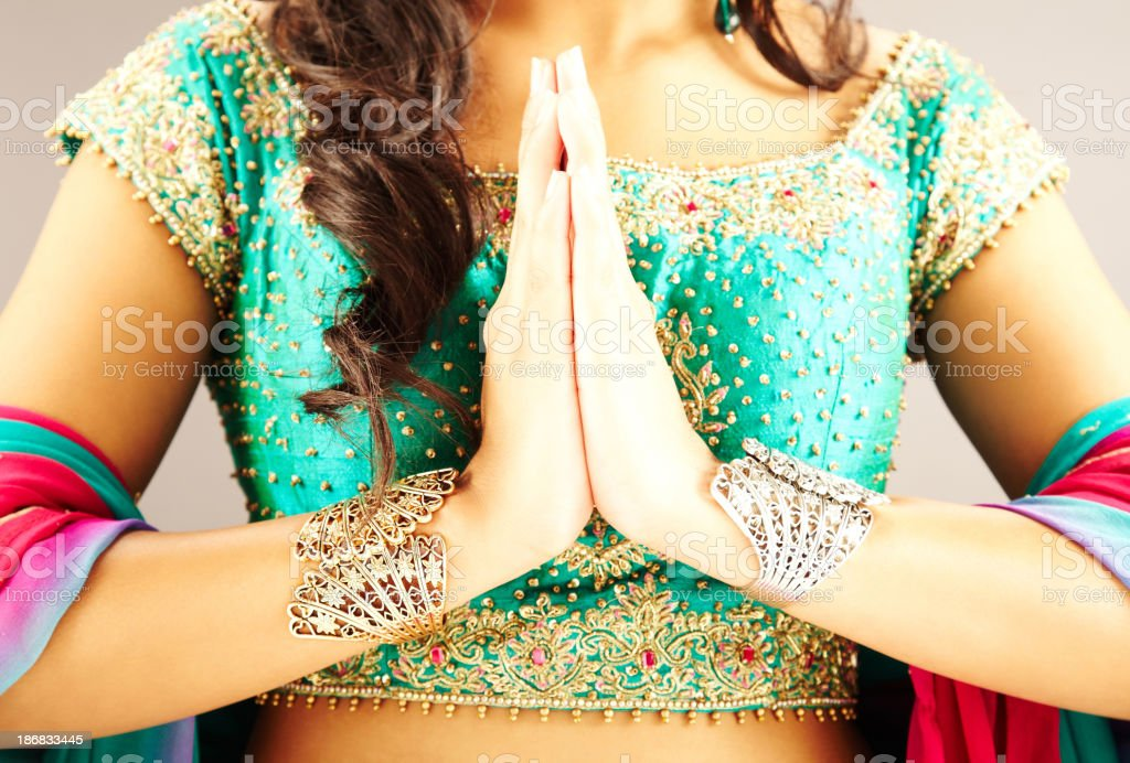 Cropped View of Indian Woman with Hands in Prayer Position stock photo