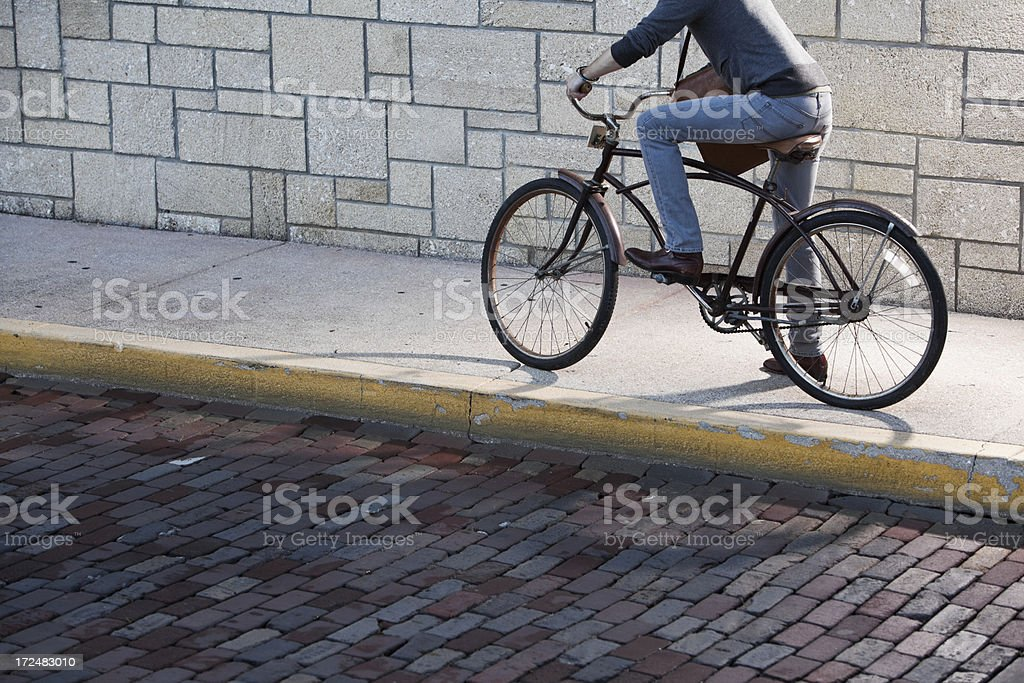 Cropped view of man riding bicycle royalty-free stock photo