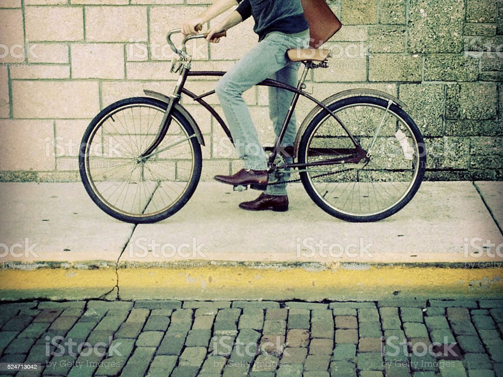 Cropped view of man riding bicycle stock photo